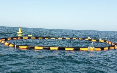 Manufacture and installation of permanent oil and debris barrier around desalination intake screens.